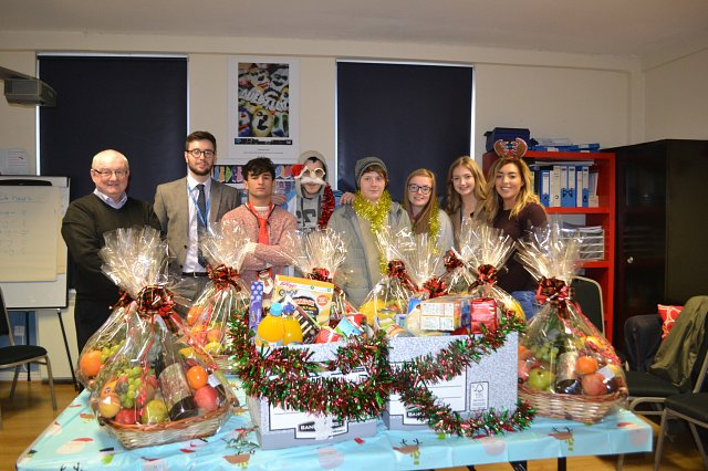 Fintru staff giving young people food hampers