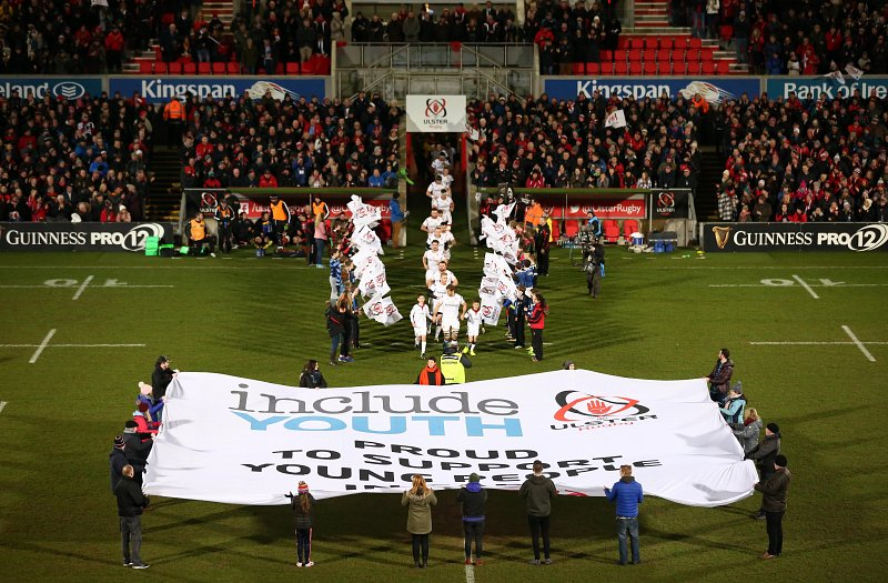 Young people, staff and volunteers from Include Youth flying their flag at the Ulster V Edinburgh Guinness PRO12 match on Friday.